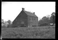 Manhasset / Roslyn / Little Neck / Douglaston / Alley Road, Long Island: [3/4 view of unidentified large saltbox house set near the top of a hill, undated.]