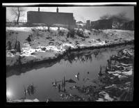 Newtown: [small creek or ditch behind unidentified buildings, winter, undated.]
