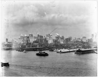 Manhattan: Lower Manhattan skyline south of Brooklyn Bridge, South Street to the docks, undated. Fulton Fish Market visible.