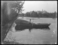 Ethel Gray Magaw Hassler in a rowboat, Central Park, ca. 1912.