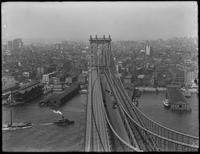 High-angle shot of the Manhattan tower of the Manhattan Bridge, Manhattan, and the piers along the East River, August 25, 1914. Shot from the Brooklyn tower of the Manhattan Bridge. Part 3 of a panorama.