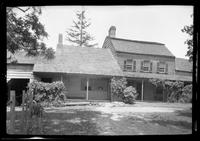 Unidentified Dutch Colonial house with multiple additions, undated. Low front angle.