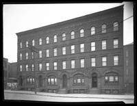 Apartment building on the north side of 4th Street [i.e. 50th Avenue] between Vernon Boulevard and Jackson Avenue, Long Island City, Queens, undated.