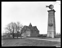 Barn and windmill, the Fox Estate, Baldwin, Long Island, April 14, 1920. Photographed for Joseph P. Day.