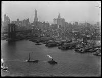 High-angle shot of the Manhattan tower of the Brooklyn Bridge and the piers along the East River, August 25, 1914. Shot from the Brooklyn tower of the Manhattan Bridge. Part 2 of a panorama.
