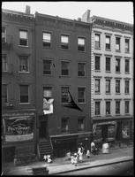97 Henry Street, New York City, June 3, 1914. Hebrew/Yiddish and Cyrillic store signs visible. Photographed for Joseph P. Day.