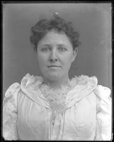 Portrait of unidentified female Hall relative [Kim or R.M. Hall?], undated. Full face shot.