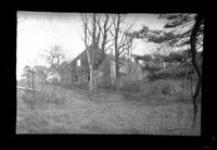 Ruins of an unidentified wood-shake saltbox house, undated.