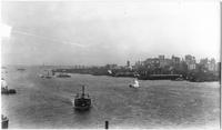Manhattan: Lower Manhattan skyline and New York Harbor viewed from Brooklyn Bridge, undated (ca. 1905).