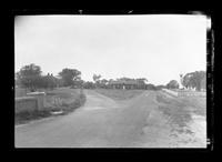 Long Island: [fork in the road, with unidentified buildings on all sides, undated.]