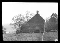 Manhasset / Roslyn / Little Neck / Douglaston / Alley Road, Long Island: [side view of unidentified large saltbox house set near the top of a hill, undated.]