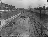 Cut for new subway tracks, 18th Avenue between 63rd Street and 64th Street, looking east from 19th Avenue, Brooklyn, May 18, 1914. Photographed for Joseph P. Day.