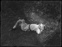William Gray Hassler (little boy) lying in the grass, ca. 1911.