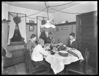 Christmas party at Harriet E. Hassler's home in Flushing, Queens; Ethel Gray Magaw Hassler, William Gray Hassler, Harriet E. Hassler and unidentified woman seated around a dinner table, December 25, 1914.
