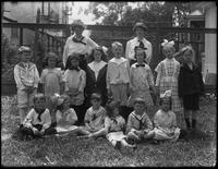 William Gray Hassler and classmates, posed in yard with teachers (Miss Howard and Miss Healey), May 29, 1914.