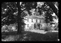 Manhasset / Roslyn / Little Neck / Douglaston / Alley Road, Long Island: [unidentified large white wood house seen through shade trees, undated.]