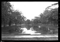 East Hampton, Long Island: [unidentified [view across East Hampton Town Pond undated. Paved sidewalk in foreground.]