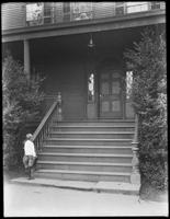 Front stairs of Gracie House [i.e. Gracie Mansion], New York City, July 31, 1914. Little boy [probably William Gray Hassler] stands at the bottom of the steps, looking up.