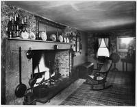 Bayshore, New York: rocking chair in front of large fireplace, Sagtikos Manor House, undated.