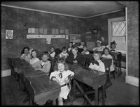 William Gray Hassler's school classroom and classmates seated at desks, May 29, 1914.