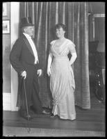 Full-length portrait shot of James R. Murphy and wife, at 1962 University Avenue, Bronx, April 25, 1915. White tie and evening gown.