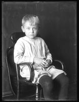 William Gray Hassler (little boy), portrait seated in high-backed chair, undated. Blurry.