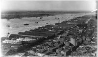 Manhattan: High-angle view of Hudson River and Manhattan docks, looking northwest from the Singer Building, 1909. West Street and New Jersey visible. Ships 'Priscilla' and 'Providence' visible at Pier 18.