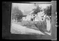 Photograph of an unidentified wood house, undated.