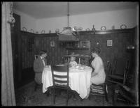 William Gray Hassler at supper with the Lee's, ca. 1911. Man, woman, and child around a dinner table.