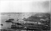 Manhattan: High-angle view of Hudson River and Manhattan docks, looking northwest from the Whitehall Building,  undated.