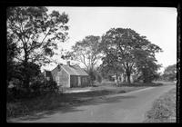 Amagansett / Wainscott, Long Island: [small unidentified wood-shake house beside dirt road, undated.]