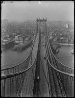 High-angle shot of the Manhattan tower of the Manhattan Bridge, Manhattan, and the piers along the East River, August 25, 1914. Shot from the Brooklyn tower of the Manhattan Bridge.