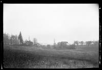 Distant, misty view of unidentified farm, undated.