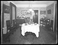 Dining room of a model apartment, New York City, May 6, 1915. Photographed for the United Electric Light & Power Company.