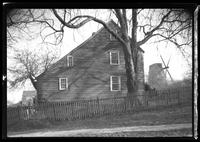 East Hampton, Long Island: [side view of unidentified saltbox house, with windmill visible behind, undated.]