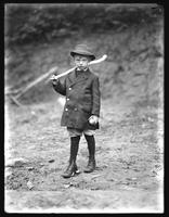 William Gray Hassler (little boy) in hat and coat, rural setting, full length portrait, 1912.