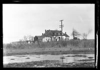 Amagansett / Wainscott, Long Island: [unidentified farm with power lines and partially flooded field in foreground, undated.]