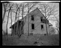 Newtown: [unidentified dilapidated wood house, gutted, undated.]
