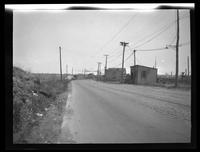 Newtown: [unidentified stretch of road with trolley tracks, small buildings, undated.]