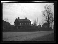 Newtown: [unidentified house on cobbled street, undated.]