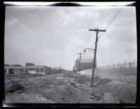 Long Island City: [unidentified waste land with industrial buildings and tank farm in the background, undated.]