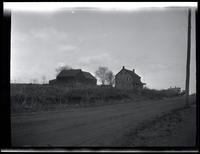 Newtown: [unidentified farm buildings by a dirt road, undated.]