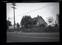 Newtown: [unidentified old wood house, undated. Life Savers billboard at right.]