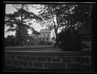 Newtown: [unidentified house, undated. Stone retaining wall in foreground.]
