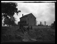 Newtown: [unidentified old wood house with covered porch, undated.]