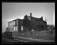 Newtown: [unidentified large old wood house on unpaved road, undated.]
