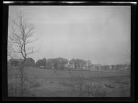 Newtown: [unidentified distant farm viewed from across grassy field, undated.]