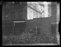 Unidentified crowd of soldiers and civilians listen to a man giving a speech in front of a plaque commemorating John Ericsson, location unidentified, ca. 1918-1919.