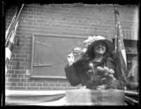 Woman speaking at podium with plaque commemorating John Ericsson behind her, location unidentified, ca. 1918-1919.