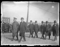 Officials walking in a funeral procession for 'Captain John [...?]', the last American casualty brought back from France, Brooklyn (?), ca. 1922.